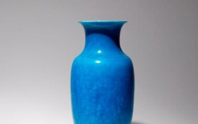 A CHINESE TURQUOISE GLAZED VASE 19TH CENTURY The ovoid body surmounted by a short waisted neck, decorated all over with a vibrant turquoise crackled glaze, together with a wood stand, 34.5cm. (2) Provenance: from a deceased estate, Hampshire.