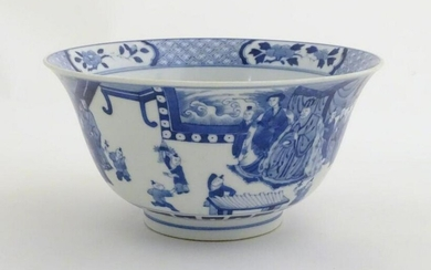 A Chinese blue and white footed bowl with a flared rim