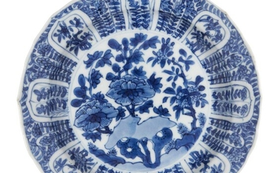 A Chinese porcelain dish, Kangxi period, painted in underglaze blue...