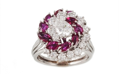 A DIAMOND AND RUBY CLUSTER RING, the central pear shaped dia...