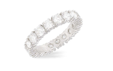 A DIAMOND ETERNITY RING Composed of a continuous...