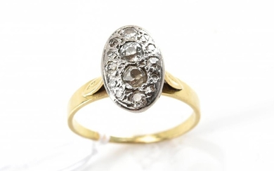 A DIAMOND RING IN 18CT GOLD AND PALLADIUM
