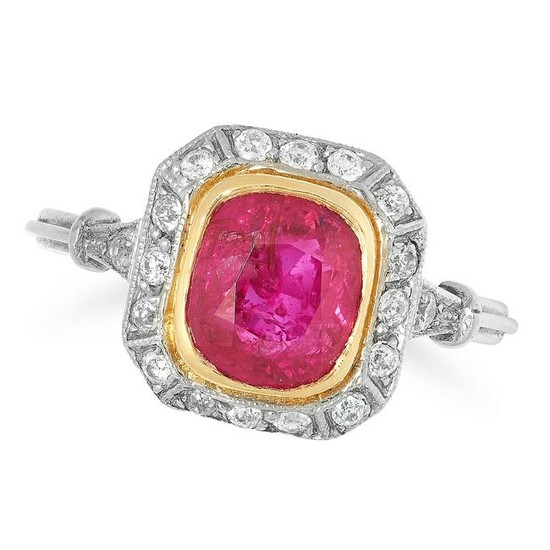 A RUBY AND DIAMOND CLUSTER RING set with a central