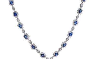 A SAPPHIRE AND DIAMOND NECKLACE - Comprising twelve oval sapphire and diamond clusters interspaced with round brilliant cut diamonds...