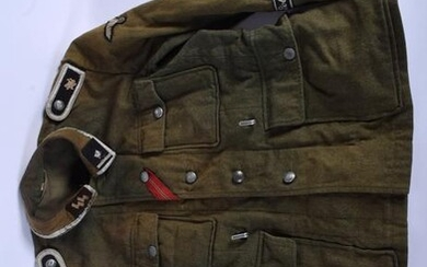 A VINTAGE GERMAN MILITARY GREEN JACKET set with