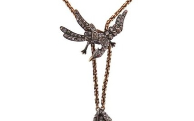 A Victorian diamond pendant, the diamond-set snake pendant in silver on gold, suspending from a gold neck chain with a sliding diamond-set phoenix pendant with a ruby eye, pendants each 2cm high, neck chain 38cm long