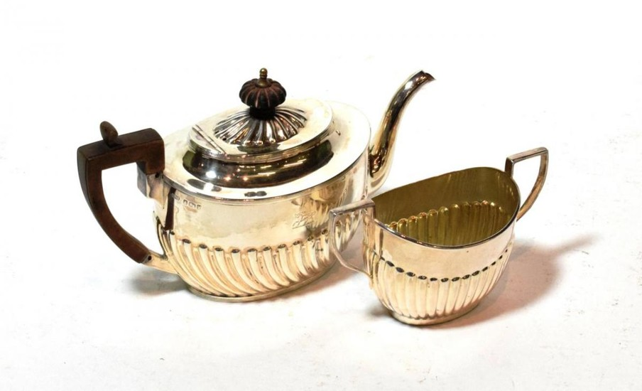 A Victorian silver teapot and a similar sugar-bowl, the teapot...