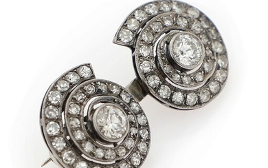 SOLD. A diamond brooch set with two diamonds weighing a total of app. 0.80 ct....