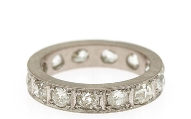A diamond eternity ring set with numerous brilliant-cut diamonds, mounted in platinum. Size 54.