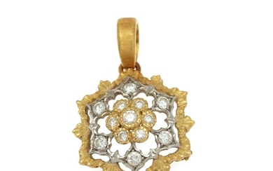 A diamond pendant set with numerous brilliant-cut diamonds, mounted in 18k gold and white gold partly with a satin finish. L. incl. eye-let app. 2 cm.
