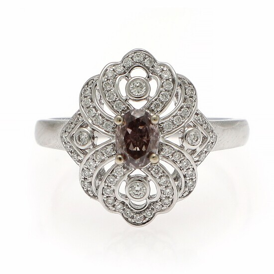 A diamond ring set with an oval-cut pink diamond weighing app. 0.42 ct. encircled by numerous brilliant-cut diamonds, mounted in 14k white gold. Size 53.