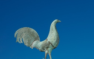 A full-bodied molded copper gamecock weathervane