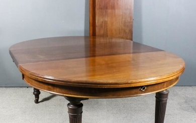 A mahogany circular extending dining table, Late Victorian, with...