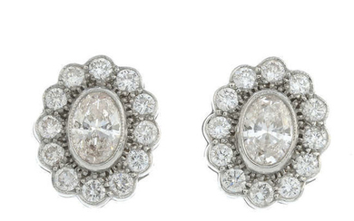 A pair of oval-shape 'pink' diamond and brilliant-cut diamond earrings.
