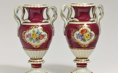 A pair of vases with snake handles