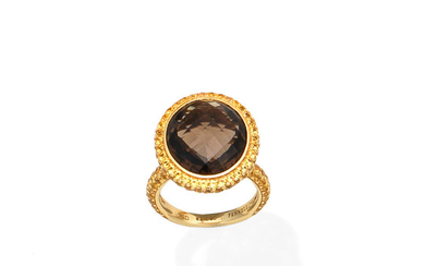 A smokey quartz and yellow sapphire dress ring, by Theo Fennell
