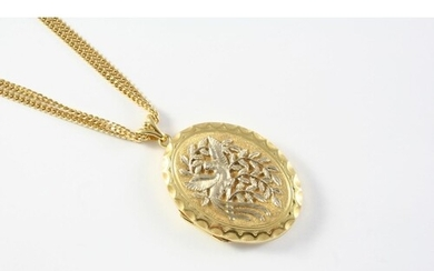 AN 18CT GOLD LOCKET PENDANT with embossed decoration to the ...