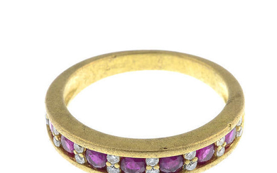 An 18ct gold ruby and diamond half-eternity ring.
