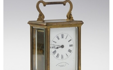 An early 20th century French brass cased carriage timepiece,...