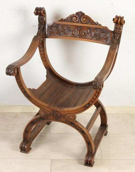 Antique walnut scissor chair with tendrils and