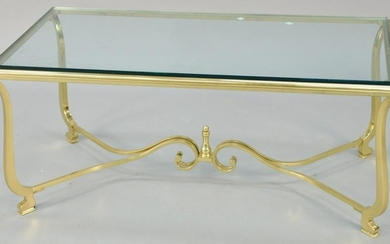 """Brass and glass coffee table. ht. 17 in., top: 21"""" x 41"""