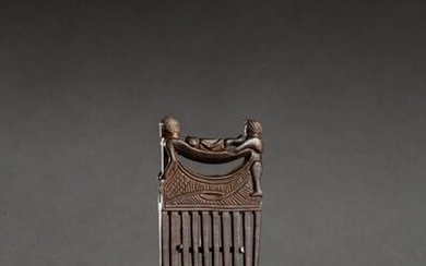 § Carved comb on the upper part of a processional...