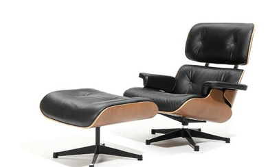 """Charles Eames, Ray Eames: """"Lounge chair New Dimensions"""". Chair and stool with moulded walnut shell. Upholstered with black leather. Vitra. (2)"""