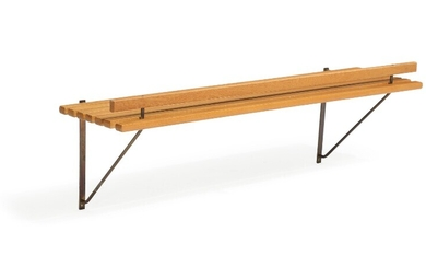 Danish design: A 1960s solid oak wall shelf with patinated brass fittings. L. 120 cm.