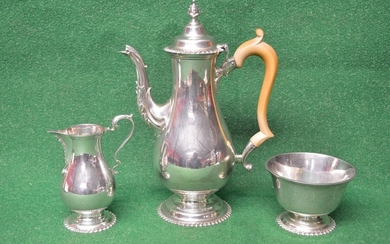Elegant three piece silver tea set to comprise: teapot, suga...