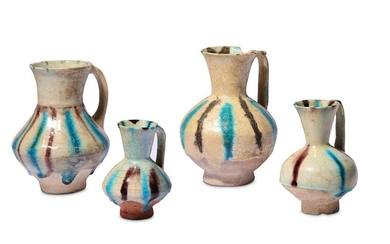* FOUR SMALL SPLASHED KASHAN POTTERY EWERS Iran, 12th - 13th century