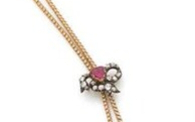 PENDENT CROSS in 18K (750) white gold and silver and its necklace set with pink topazes and antique cut diamonds, sliding on an 18K (750) yellow gold chain.