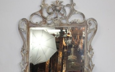 Rococo style carved and painted wood mirror