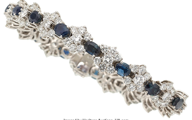 Sapphire, Diamond, White Gold Bracelet The bracelet features oval-shaped...