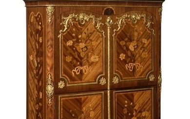 Secretary with flap in flower marquetry, satin and amaranth, opening with two leaves and a flap revealing seven drawers, six compartments and a secret compartment with a sliding shelf, the front with gilded bronze frames, the top in yellow Sienna...