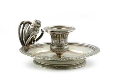Silver hand candlestick. Paris 1809-1819. Exceptional candlestick decorated...