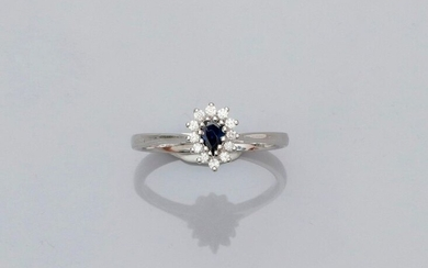 Small white gold ring, 750 MM, centered on a pear-cut sapphire surrounded by diamonds, size: 54, weight: 3.4gr. rough.
