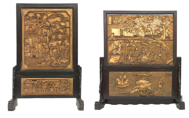 Two gilt-wood and lacquer table screens on stained-wood stands