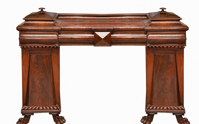 Victorian sideboard in carved wood, mahogany and mahogany palm. England, c. 1860. With two compartments with a top lid, four drawers at the waist and two compartments with doors at the bottom. On four claw feet. Measurements: 120x61x167 cm.