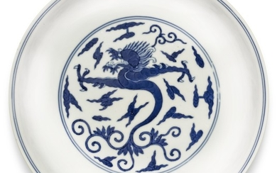 A BLUE AND WHITE MING-STYLE 'DRAGON' DISH JIAQING SEAL MARK AND PERIOD | 清嘉慶 青花卷草雲龍紋盤 《大清嘉慶年製》款