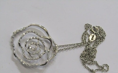 18ct WHITE GOLD DIAMOND SET FLORAL DESIGN PENDANT on 18ct wh...