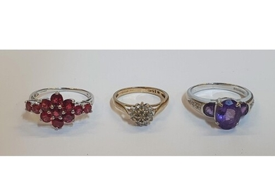 3 9ct gold rings which include a white gold set with 3 large...