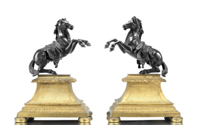 A pair of French patinated bronze models of rearing horses in the manner of models by Francesco Fanelli (Italian, 1577-after 1641) raised on gilt bronze bases