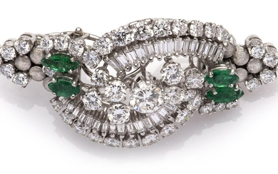 A 14k white gold emerald and diamond brooch