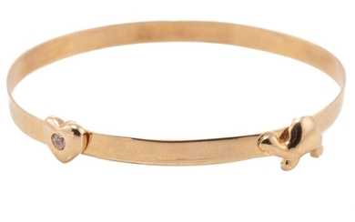 A 9CT GOLD BABY BANGLE; 3mm wide slide bangle applied with a turtle and zirconia set heart, size 11-13.5mm, wt. 2.10g.