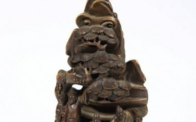 A BAMBOO ORNAMENT WITH STORY CARVED