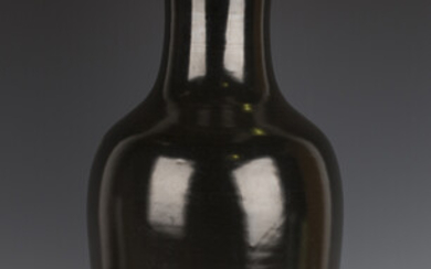 A Chinese dark brown/black glazed porcelain vase, Kangxi period, of baluster form with flared neck