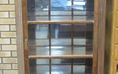 A Continental walnut and glazed Cabinet fitted single door...
