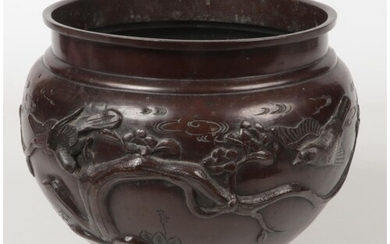A Japanese Meiji period patinated bronze planter of plain fo...