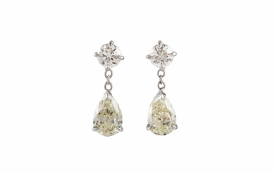 A PAIR OF DIAMOND DROP EARRINGS, with two pear shape brillia...