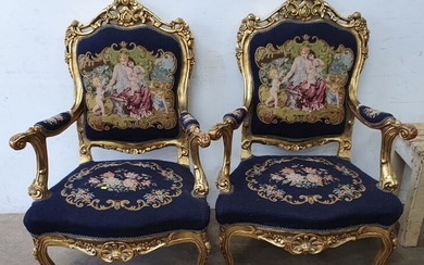 A PAIR OF GILT FRAMED FRENCH STYLE ARM CHAIRS